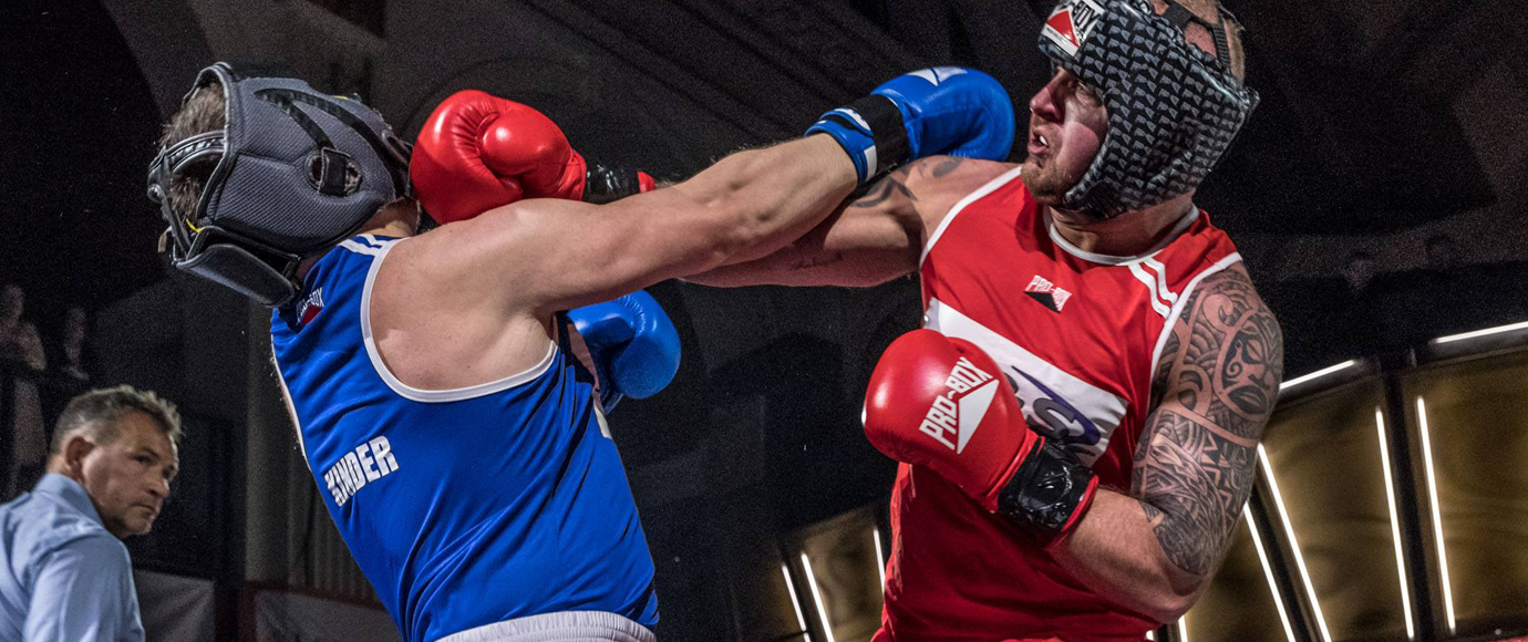 Two heavyweights punching in the Corporate Boxing main event