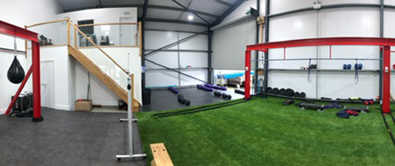 Wide angle image from the front of the Tower Fitness Fakenham Gym building