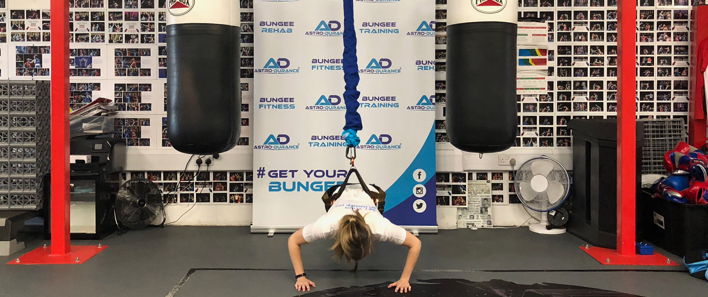 Performing press ups using the Bungee Fitness programme at Tower Fitness Fakenham Gym